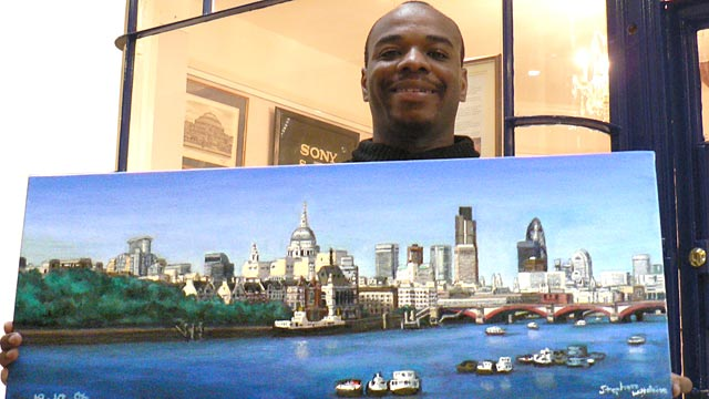 PHOTO: Artist Stephen Wiltshire, who can draw detailed panoramas after seeing a city just once, stands in front of his gallery.