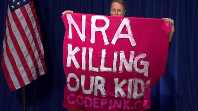 A protester interrupted NRA Executive Vice President Wayne LaPierre during a press conference on Friday December 21st, after the Newtown, Connecticut, massacre of last week in which 20 children and 6 adults were massacred.