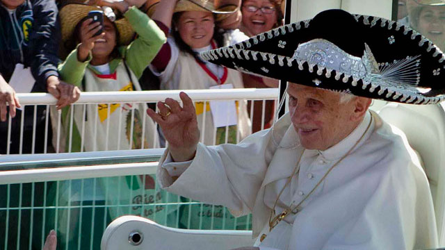 In this Sunday, March 25, 2012 file photo, Pope Benedict XVI waves from the popemobile wearing a Mexican sombrero as he arrives to give a Mass in Bicentennial Park near Silao, Mexico.