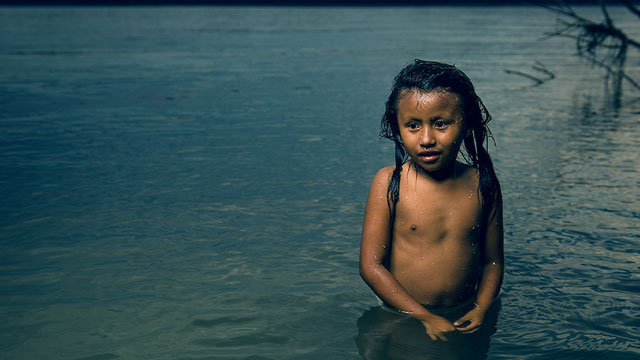 "A still from the short documentary ""Yasuni"" directed by Nicolas Entel. An indigenous girl bathes in the Napo River, the gateway to the Yasuni National Park in Ecuador, which is endangered by oil expolitation."