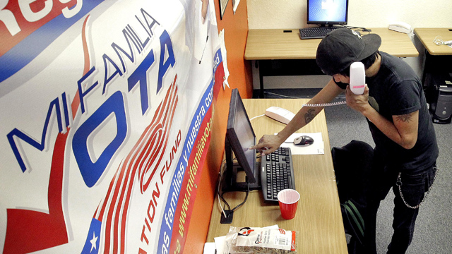PHOTO:Pedro Yazzie, 27, makes phone calls Tuesday, Nov. 6, 2012 in Phoenix to registered voters from the offices of Mi Familia Vota, a non-partisan effort to increase voter participation among Latinos and others.