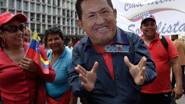 """PHOTO:A man wearing a handcrafted mask depicting the face of Venezuelas President Hugo Chavez attends an event commemorating the violent street protests of 1989 known as the """"Caracazo,"""" in Caracas, Venezuela, Wednesday, Feb. 27, 2013."""
