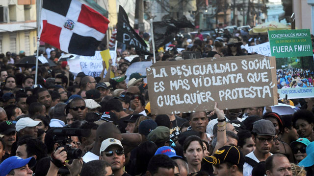 PHOTO:Dominicans attend a demonstration against the fiscal reform in Santo Domingo, Dominican Republic, Sunday, Nov. 11, 2012. The measure will increase the general sales tax to 18 percent from 16 percent, will raise the price of gasoline and impose taxe