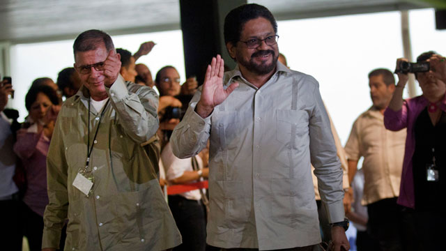 PHOTO: Ivan Marquez, right, and Ricardo Tellez, members of the negotiation team for Colombias Revolutionary Armed Forces of Colombia, or FARC, wave as they arrive for peace talks in Havana, Cuba, Monday, Nov. 19.