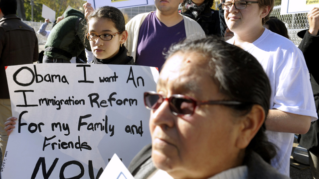PHOTO: Diana Saravia, 10, of Beltsville, Md., left, demonstrates along with members of immigration rights organizations in front of the White House as they call on President Barack Obama to fulfill his promise of passing comprehensive immigration reform.