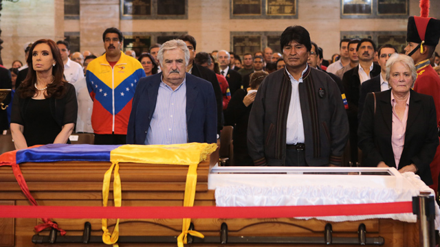 PHOTO:Leftist allies of President Hugo Chavez stand by his coffin in this photo taken in Caracas on March 6, 2013.