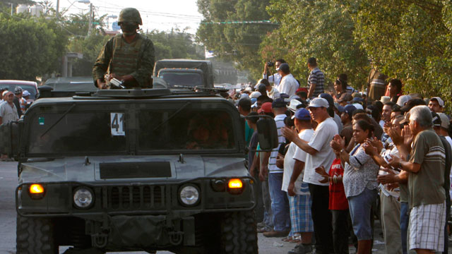 PHOTO: Mexican army soldiers entered the town of La Ruana, Michoacan on Monday, May 20, 2013. Residents of western Mexico towns who endured months besieged by a drug cartel are cheering the arrival of hundreds of Mexican army troops.