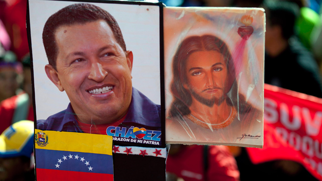PHOTO:A picture of Venezuelas President Hugo Chavez is held up alongside an image of Jesus Christ at a rally by Chavez supporters in Caracas, Venezuela, Thursday, Jan. 10.