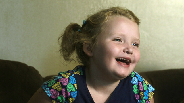 "PHOTO: In this Sept. 10, 2012 file photo, seven-year-old beauty pageant regular and reality show star Alana ""Honey Boo Boo"" Thompson gestures during an interview in her home in McIntyre, Ga."