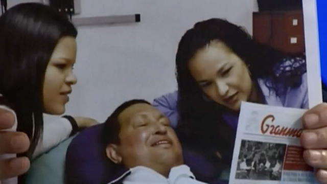 PHOTO:Hugo Chavez smiles in Cuba next to his daughters