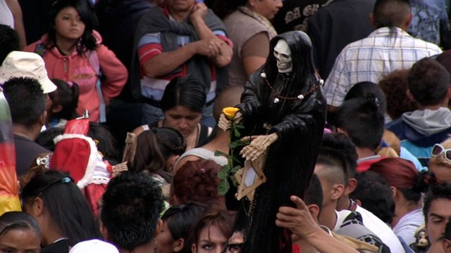 In Tepito, a Mexico City neighborhood, hundreds gather to offer la Santa Muerte gifts.