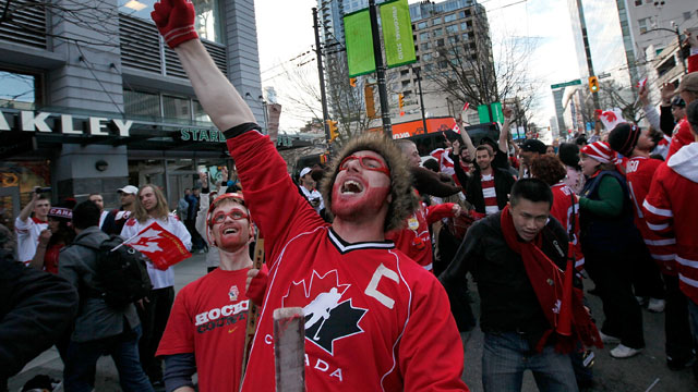 PHOTO: Fans celebrate in the streets after Canada defeated the USA 3-2 in overtime to win the gold medal in ice hockey at the 2010 Olympic winter games. Canada also beats the U.S. in the 2013 Global Peace Index, by a lot.