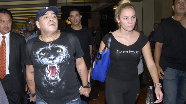 PHOTO:Diego Maradona, was planning to visit Disneyland with 23-year-old girlfriend Rocio Oliva (right), according to The Sun.