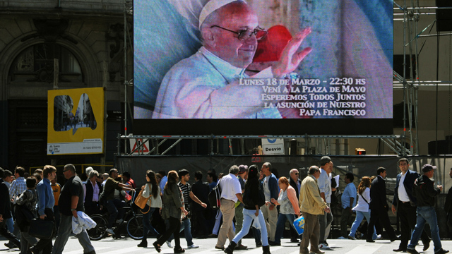 PHOTO:A screen in Buenos Aires, Argentina invites people to gather in the Plaza de Mayo to watch the Popes inauguration ceremony. Catholics around the world expect different things from the new Pope.