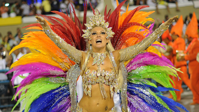 PHOTO:A reveller of Mocidade samba school dances during the first night of carnival parade at the Sambadrome in Rio de Janeiro on February 20, 2012.