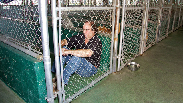 PHOTO:Michael Rosenberg inside the cage where he will live two days in order to raise awareness on animal rights.