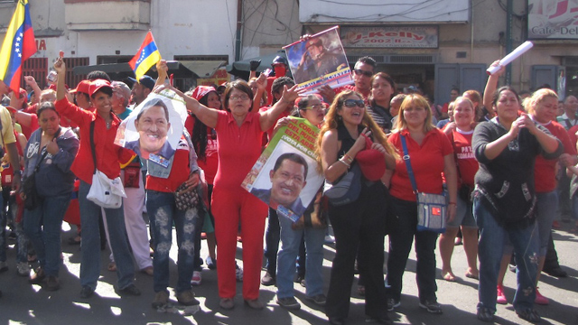 PHOTO:After news of Hugo Chavez´s return to Venezuela broke out, some of his supporters gathered in front of the Carlos Arvelo Military Hospital in Caracas. Chavez will continue treatment in a secluded area of the hospital.