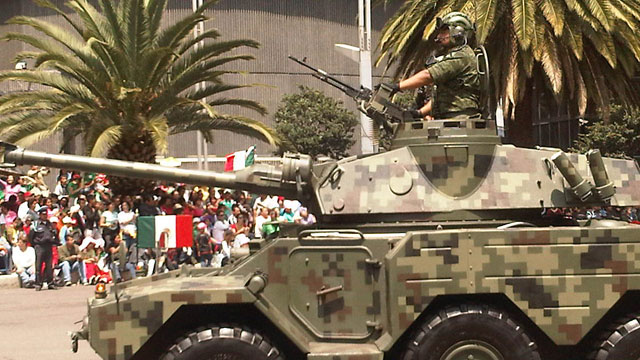PHOTO: An armed vehicle parades the streets of Mexico City during recent independence day celebrations. Over the past six years the Mexican government has increasingly deployed the military to fight drug gangs around the country.