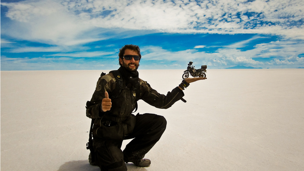 PHOTO:Alex Chacón creates an optical illusion in Bolivias Uyuni salt flat. Chacón a 25-year-old from El Paso, Texas travelled from Alaska to the southern tip of Argentina on a Kawasaki motorbike. He traveled for more than 500 days.