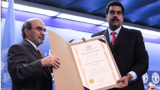 PHOTO: Venezuelan President Nicolas Maduro, poses with FAO director Jose Graziano da Silva. On Sunday, The FAO, aawarded Venezuela a special certificate for reducing hunger by half, despite current food shortages in the South American nation.