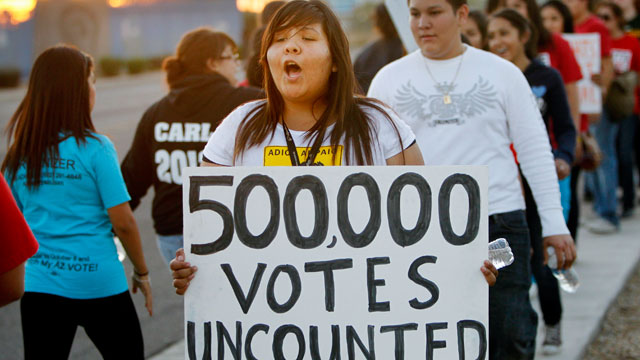 PHOTO: Brianda Lopez 15, joins Unite Here and Promise Arizona in Action to protest outside the Maricopa Ballot Tabulation Center Wednesday, Nov 7, 2012 in Phoenix.