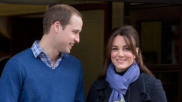 PHOTO: Britain's Prince William stands next to his wife Kate, Duchess of Cambridge as she leaves the King Edward VII hospital in central London.