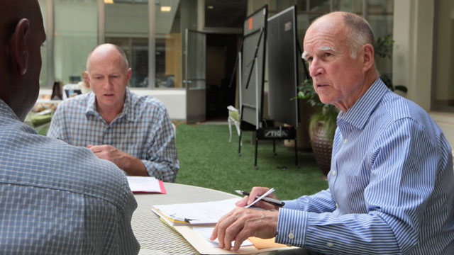 PHOTO: Gov. Jerry Brown, right, discusses a bill with Legislative Affairs Secretary Gareth Elliott