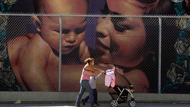 PHOTO: A mother walks with her children to the MacArthur Park Primary Center School in Los Angeles Thursday, Jan. 31, 2013. Within six months, Californias Hispanic population will equal that of whites.
