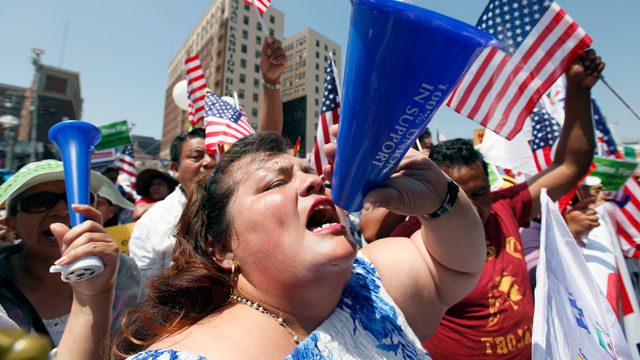 PHOTO: Emilia Hernandez shouts during a May Day rally in downtown Los Angeles on Wednesday, May 1, 2013.