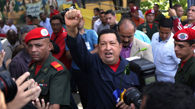 PHOTO:Venezuelas President Hugo Chávez arrives to a polling station during the presidential election in Caracas, Venezuela, Sunday, Oct. 7, 2012. Chávez is running for re-election against opposition candidate Henrique Capriles.