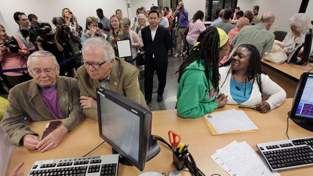 PHOTO:In this file photo taken June 1, 2011, in Chicago, Jim Darby, 79, and his partner Patrick Bora, 73, and Janean Watkins, 37, and her partner, Lakeesha Harris, 36, wait at the Cook County Office of Vital Records to obtain civil union licenses.