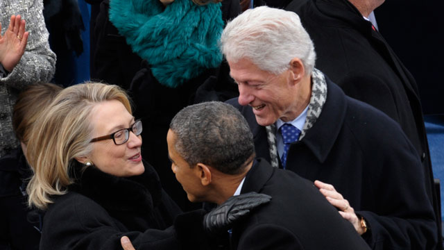 PHOTO: President Barack Obama is greeted by Secretary of State Hillary Clinton and former President Bill Clinton.