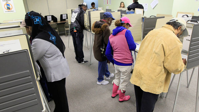 PHOTO:People vote inside the Hamilton County Board of Elections after it opened for early voting, Tuesday, Oct. 2, 2012, in Cincinnati. Ohioans can cast an early ballot by mail or in person beginning Tuesday for the Nov. 6 election.