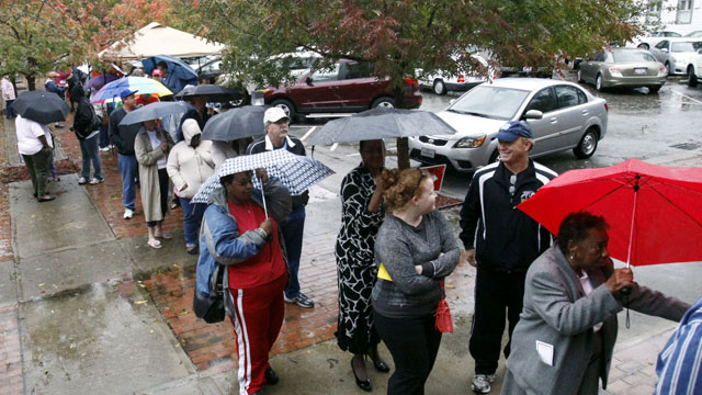 Voters wait in line despite rains from Hurricane Sandy to vote on the last early voting Sunday before election day, in New Bern, N.C., on Oct. 28, 2012. Early voting ends in Craven County on November 3.