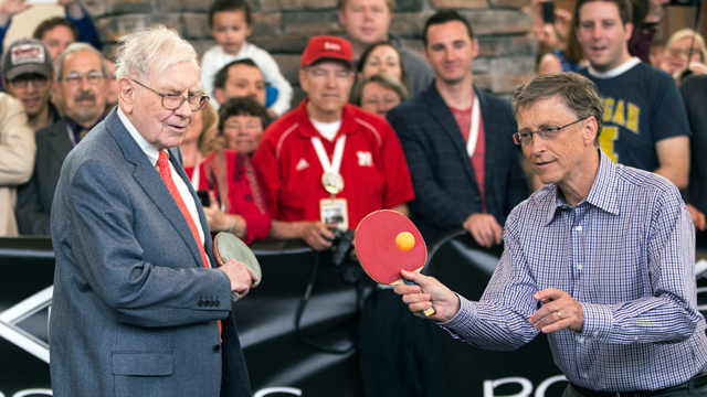 PHOTO:Berkshire Hathaway Chairman and CEO Warren Buffett, left, and Microsoft founder and Berkshire director Bill Gates are watched by shareholders as they play table tennis in Omaha, Neb., Sunday, May 5, 2013.