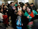 PHOTO:Supporters of granting undocumented immigrants drivers licenses cheer after a House committee hearing at the Illinois State Capitol Monday, Jan. 7, 2013, in Springfield Ill.