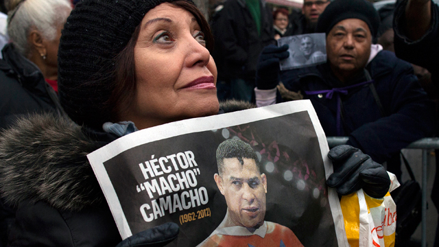 "PHOTO: Magaly Diaz, of New York, watches as a procession carries Hector ""Macho"" Camachos casket after a funeral at St. Cecilias Roman Catholic Church in New York, Saturday, Dec. 1, 2012. D"