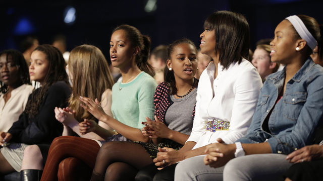 "PHOTO: First lady Michelle Obama and daughters Sasha, center, and Malia react as Usher performs during the Kids' Inaugural: Our Children. Our Future."" event in Washington, Saturday, Jan. 19, 2013."