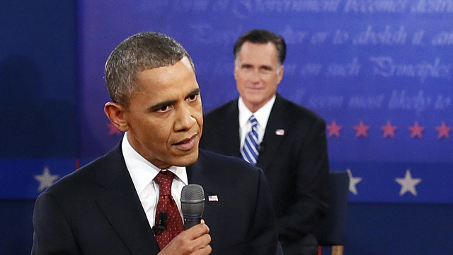 PHOTO:President Barack Obama answers a question as Republican presidential nominee Mitt Romney listens during the second presidential debate at Hofstra University, Tuesday, Oct. 16, 2012, in Hempstead, N.Y.