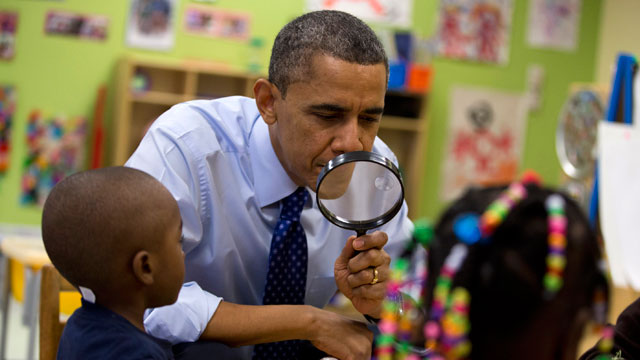 PHOTO:President Barack Obama looks through a magnifying glass during a learning game at a pre-kindergarten classroom at College Heights Early Childhood Learning Center in Decatur, Ga., Thursday, Feb. 14, 2013.