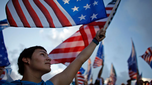 PHOTO: A pro-statehood New Progressive Party supporter waves the U.S. flag during the partys closing campaign rally in San Juan, Puerto Rico, Saturday, Nov. 3, 2012.