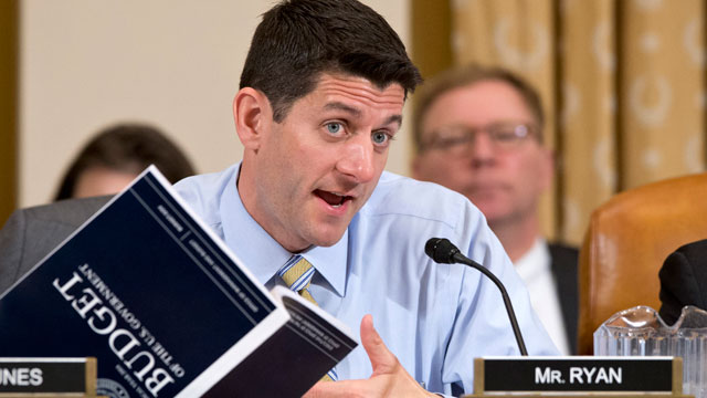 PHOTO:  Paul Ryan, R-Wis., a member of the House Ways and Means Committee, holds a copy of President Barack Obamas fiscal 2014 budget proposal book.