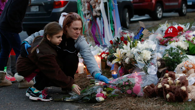 PHOTO: Mourners gather for a candlelight vigil at Rams Pasture to remember shooting victims, Saturday, Dec. 15, 2012 in Newtown, Conn.