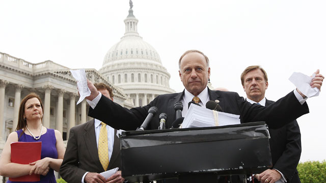 PHOTO:U.S. Rep. Steve King (R-Iowa) tears a page from the national health care bill during a press conference at the U.S. Capitol March 21, 2012 in Washington, D.C.