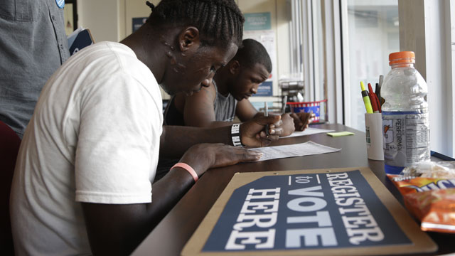 PHOTO: Blake West, 20, left, and Dehjahn Swain, 19, right, register to vote at a campaign office for President Barack Obama, Monday, Oct. 8, 2012 in Miami. Tuesday is the last day to register to vote in the general election Nov. 6.