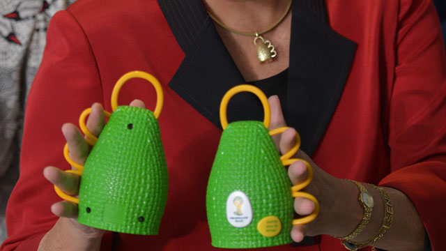 PHOTO:Brazils President Dilma Rousseff holds caxirolas during their official presentation at the Planalto Palace.