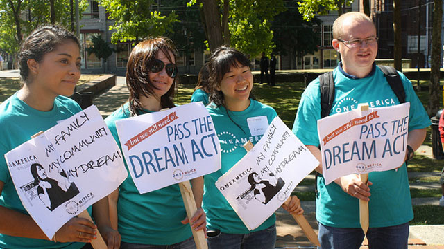 PHOTO:Young people hold signs in support of the DREAM Act.