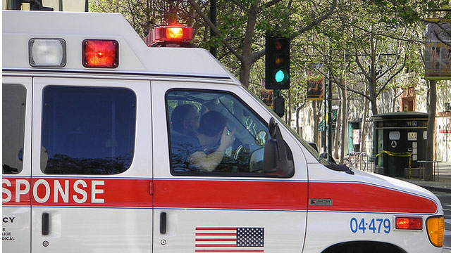 PHOTO: Emergency responders drive an ambulance. For many poor and underinsured patients, many of whom are chronically ill as a result of not having regular medical attention, the emergency room serves as their main healthcare provider.