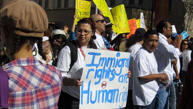 PHOTO:Immigration activists protest Georgias immigration law at a rally in 2011.