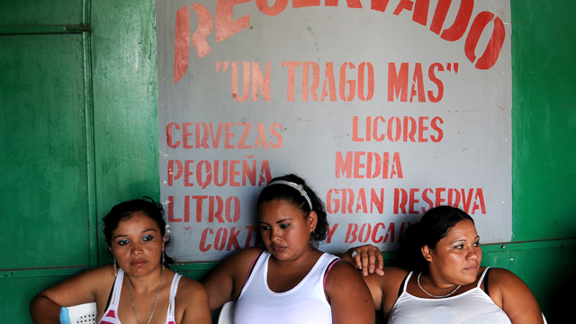 PHOTO:Nicaraguan sex workers and Yajaira, Alejandra, and Jessica wait for clients at a brothel in Managua. Sex trafficking in Latin America generates an estimated $16 billion in business annually.